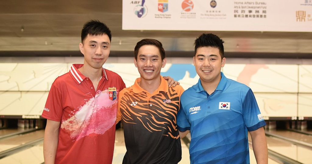 Top three men after 2/3 squads - from left, Michael Mak, Timmy Tan and Park Jong Woo.