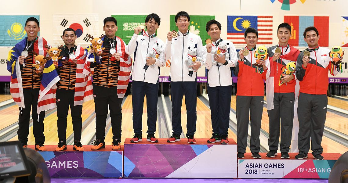 Japanese men successfully defend men's trios title at 18th Asian Games